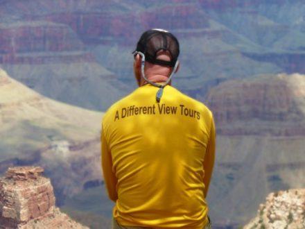 Jon Albert Sitting on Grand Canyon Rim